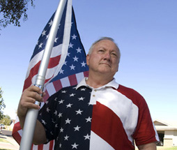 Russell Pearce holding American Flag photo
